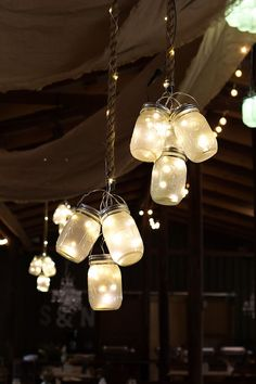 For Ann ~ Clusters of frosted LED mason jar lights hung from the ceiling at this rustic barn wedding.