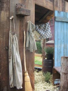 Door of the barn or stables. Broom to sweep away straw, old apron for milking the cows.