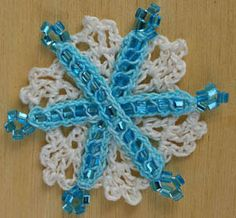 11 Free Crochet Patterns for Pretty, Festive Snowflakes: Beaded Crochet Snowflake - Free Pattern