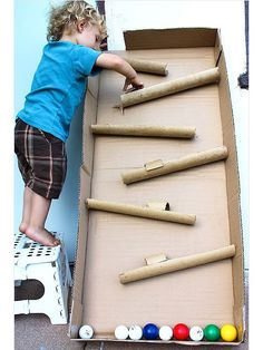 Make with a cardboard box and paper towel rolls -- ball drop maze