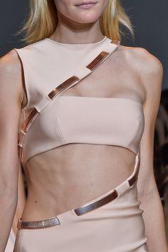 Asymmetric cutout dress with copper trim; fashion details // Thierry Mugler Spring 2015