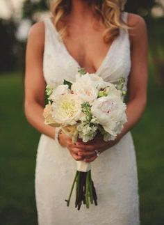 Simple and elegant white bouquet. With a little forget me not or other small blue flowers?