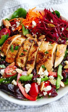 Grilled chicken salad, loaded with a variety of healthy greens and vegetables, and topped with a delicious citrus vinaigrette, slivered roasted almonds, feta cheese and dried cranberries. #bbq #bbqrecipes #bbqsauce #bbqchicken #bbqparty #grillingrecipes #grillrecipes #chicken #healthy #healthyrecipes #chickenrecipes #health