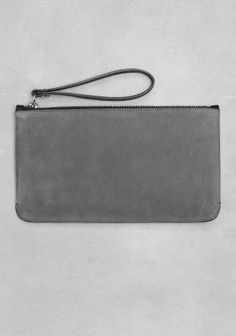 & OTHER STORIES Made from a mix of elegant nubuck and smooth leather, this clutch features a clean, timeless design.
