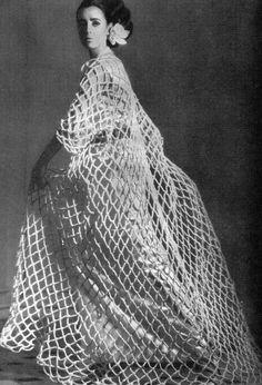 Maggi Eckardt in a fishnet coat of white velvet made by Judith Barbier for Balenciaga, 1964 - Photo by Tom Kublin