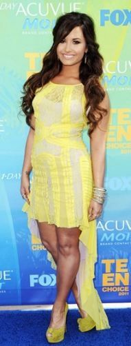 Who made Demi Lovato's yellow dress and pump that she wore in Universal City on August 7, 2011? Dress – BCBG Shoes – Christian Louboutin