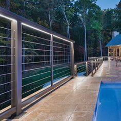 Photo of DesignRail® LED Lighting on tiled deck Cable Railing, Deck Railings, Deck Lighting, Exterior Lighting, Exterior Stairs, Interior And Exterior, Deck Replacement Ideas, Laser Cut Aluminum, Courtyard Pool