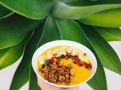 Mango nice cream - vegan style! Topped with granola,banana,nuts and seeds. #breakfastbowl #vegan #wellnessinthecity