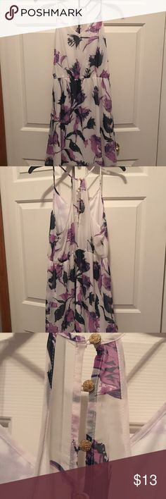 """White dress with purple flowers Gorgeous white dress with purple flowers and gold accent buttons in the back. I'm 5'4"""" and it goes just about to the top of my knee. Only worn a handful of times! Pink Owl Dresses"""