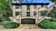 The home features the rounded edges, glazed brick facade, glass block windows, and Art Deco-inspired exterior lighting that typify the Moderne architectural style.