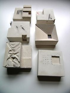 Tabulation by Rachel Hurst, plaster & mixed media relief castings, 75×75×40 mm.