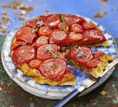 Slow-roast tomato Tatin. Make a savoury tarte tatin with sweet and sour-slow cooked tomatoes on a crisp puff pastry base