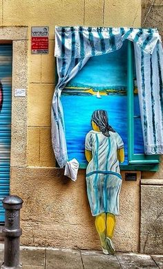 Painting 5: I really enjoyed this certain street art because it is 3 dimensional and reminds me of the beautiful beaches in Spain. I feel as if this women is craving adventure & creativity, and maybe she has not had the opportunity to do so.