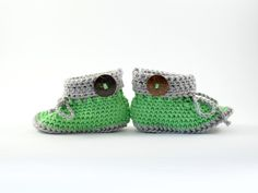 handmade yellow baby booties with flower and coconut button by from Mela with Love