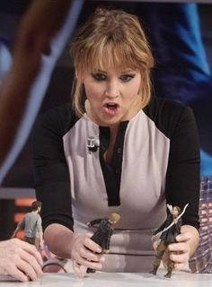 Jennifer Lawrence she is so funny playing with the hunger games action figures.