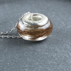 My newest make another custom horse hair bead attached to a sterling silver chain check out my store for my latest makes