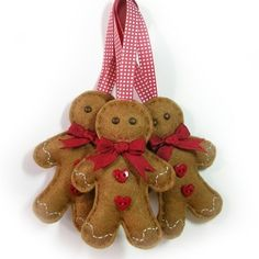 Felt gingerbread men. Made these when i was younger..Need some for MY tree!