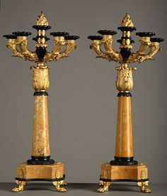An important pair of five lights candelabras in gilt and patinated bronze and Sienna marble.Like under the Restauration, the decorative arts under Louis-Philippe are pleasant, kind to deligh