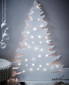 a white Christmas tree silhouette wall art with lights is great for a minimalist space or a Nordic one Christmas Tree Silhouette, Wall Christmas Tree, Beautiful Christmas Trees, Magical Christmas, Noel Christmas, White Christmas, Christmas Tree Ornaments, Christmas Crafts, Ornaments Ideas