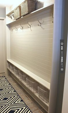 Nice - turn a narrow hallway into a mudroom using just 5 inches - very functional