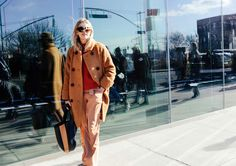 Camille Charriere in a Ganni coat, Topshop top, and Tibi pants