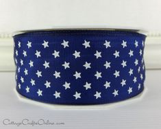 "Navy blue taffeta printed with white stars on a lightly wired edge ribbon, 1 1/2"" wide. From the Cottage Crafts Online shop on Etsy, where we help your ideas become creations."