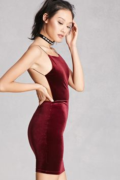 A velour dress featuring elasticized cami straps, a backless design, and a square neckline. This is an independent brand and not a Forever 21 branded item.
