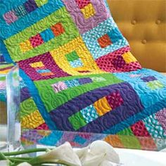 "This fun twin size quilt pattern is a great way to use up assorted bright fabrics from your stash. Finished size: 60-1/2"" x 90-1/2"". Find the free quilt pa"