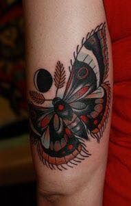 Red Lunar Moth. This is an awesome tattoo.