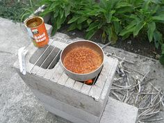 Design: Five Block Rocket Stove. All kinds of awesome. I'm doing this next cookout.
