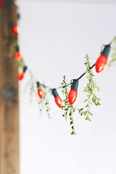 Christmas string lights are a great holiday decorating choice for the kitchen because you can hang them high on a wall or ceiling where they won't interfere with traffic flow. In an open-plan space, choose strings with large bulbs that can be easily seen from adjoining rooms. For a more natural look, add a sprig of greenery between each pair of bulbs.