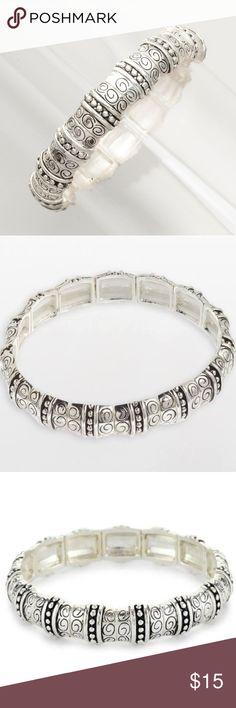 Napier Silver-Tone Textured Stretch Bracelet Charming antique silver-tone cuff bracelet with segmented square linksand pressed filigree details. Napier Jewelry Bracelets