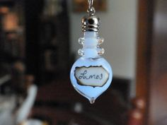 Harry Potter Lumos Glow In The Dark Glass Bottle Necklace.