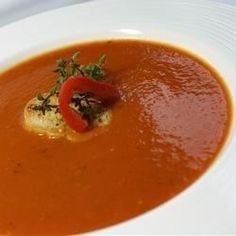 Roasted peppers, tomatoes, sauteed aromatics and seasonings are cooked in chicken broth,  strained, pureed, and thickened with a roux to create this creamy soup.