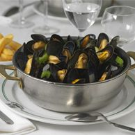 Moules frites - and one of the best spots for it is Aux Armes des Bruxelles in Brussels, Belgium