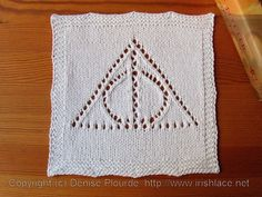 Deathly Hallows washcloth.  John wants me to make this - as soon as I finish his scarf.