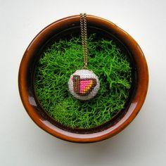 Cross-stitched pendant