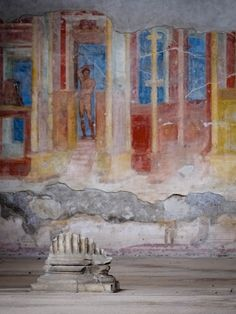 Mural paintings and the base of a broken column, at Pompeii