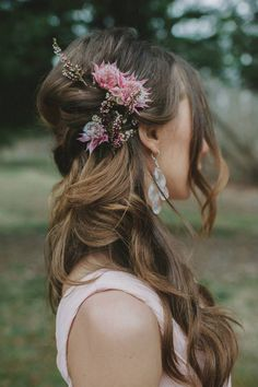 bridesmaid hairstyle with fresh flowers... long hair