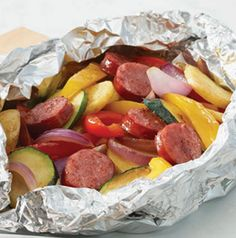 Toss chopped peppers, potatoes, zucchini, red onion and sausage (I used turkey kilbasa) with olive oil, salt, pepper and garlic powder. Seal in an aluminum foil pouch and bake at 400 for 40ish minutes.