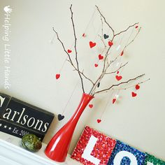 Yesterday I shared my melted crayon LOVE tiles that I made for our mantel. Once I finished them, though, there was still something miss...
