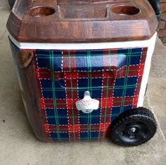Painted cooler for mountain weekend. Plaid background with beer opener on side