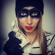 Easy makeup for Halloween. Some back eye liner and go over it with black powder eye shadow to set it. Then a silver shadow around your eyes and around the mask! #easycostume #makeup #robber #redlip