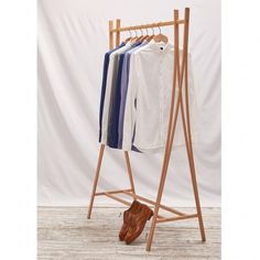 Sculpted by Japanese born but East London based designer Tomoko Azumi, the Tra-Ra embodies the East Asian penchant for producing light, modern furnishings.The simple design means this clothes rail can be used in a variety of ways, from the bedroom and Clothes Rail, East London, Photo Look, Hardwood Floors, Wood Flooring, Simple Designs, Home Furniture, Cool Photos, Contemporary
