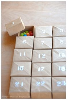homemade advent calendar paper craft box origami. This link has over 100 advent calendar ideas : http://www.thecraftycrow.net/adventcountdown-calendars/