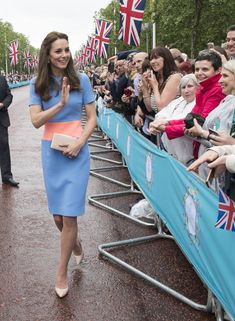 """Catherine, Duchess of Cambridge greets guests attending """"The Patron's Lunch"""" celebrations for The Queen's 90th birthday on The Mall on June 12, 2016 in London, England."""