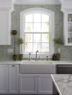 love the grey subway tiles, white cabinets, farmhouse kitchen sink