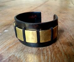 The designer's own new favorite is this cool statement leather cuff with textured brass. www.annasukardi.com