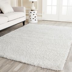Features:  -Handmade and hand-tufted.  -Material:100% polypropylene.  Technique: -Shag and flokati.  Primary Color: -White.  Product Care: -Professional cleaning is recommended.  Product Type: -Area R