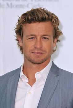 "Simon Baker Photos Photos - Actor Simon Baker poses during a photocall for ""The Mentalist"" tv series at Grimaldi Forum on June 9, 2010 in Monte-Carlo, Monaco. - 50th Monte Carlo TV Festival - Day 3"